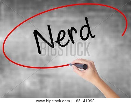 Woman Hand Writing Nerd With Black Marker Over Transparent Board