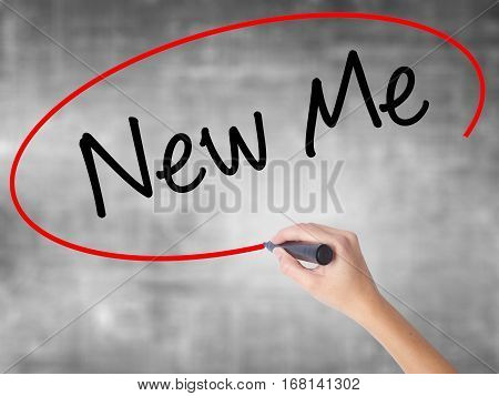 Woman Hand Writing New Me With Black Marker Over Transparent Board