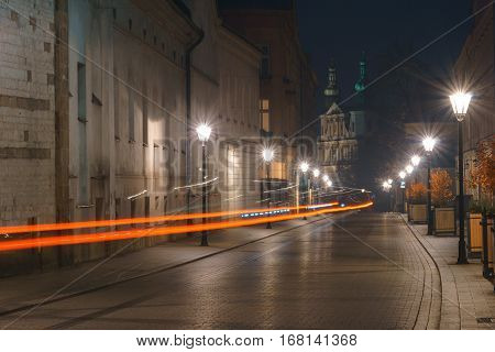 Car trails on the early morning street in the Kracow Poland.