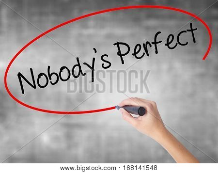 Woman Hand Writing Nobodys Perfect With Black Marker Over Transparent Board