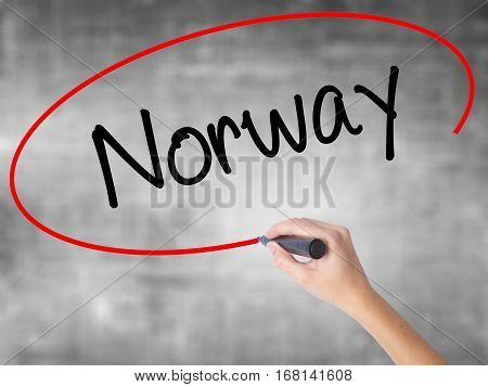Woman Hand Writing Norway  With Black Marker Over Transparent Board