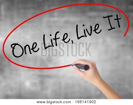 Woman Hand Writing One Life Live It With Black Marker Over Transparent Board.