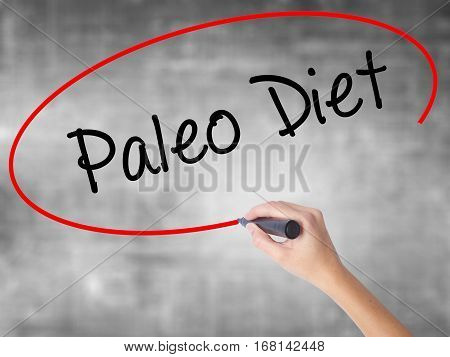 Woman Hand Writing Paleo Diet With Black Marker Over Transparent Board