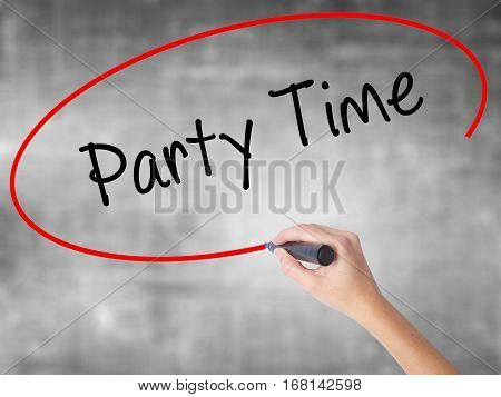 Woman Hand Writing Party Time With Black Marker Over Transparent Board