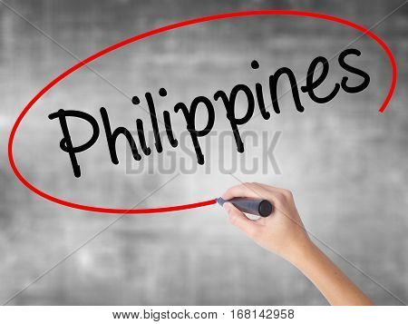 Woman Hand Writing Philippines With Black Marker Over Transparent Board