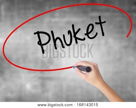 Woman Hand Writing Phuket With Black Marker Over Transparent Board