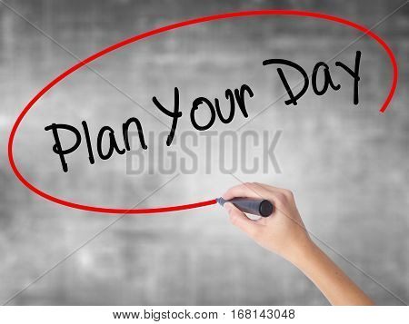 Woman Hand Writing Plan Your Day With Black Marker Over Transparent Board