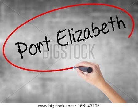 Woman Hand Writing Port Elizabeth  With Black Marker Over Transparent Board