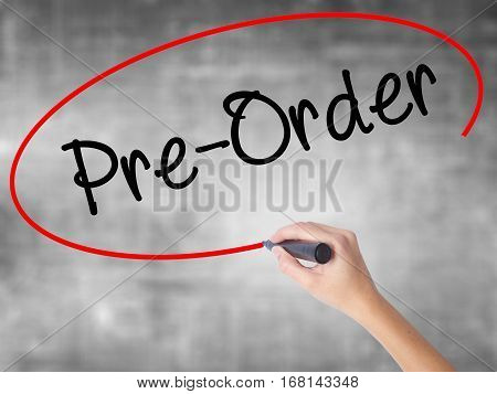 Woman Hand Writing Pre-order  With Black Marker Over Transparent Board