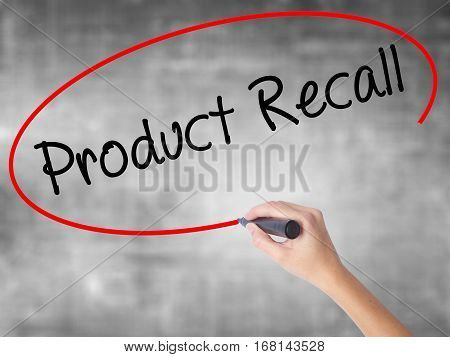 Woman Hand Writing Product Recall With Black Marker Over Transparent Board
