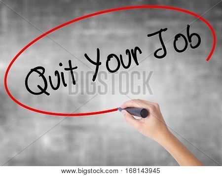 Woman Hand Writing Quit Your Job With Black Marker Over Transparent Board.