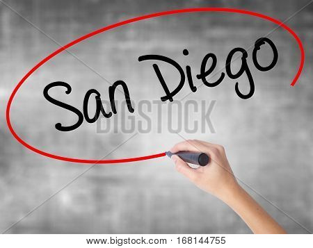 Woman Hand Writing San Diego With Black Marker Over Transparent Board