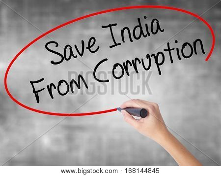 Woman Hand Writing Save India From Corruption With Black Marker Over Transparent Board