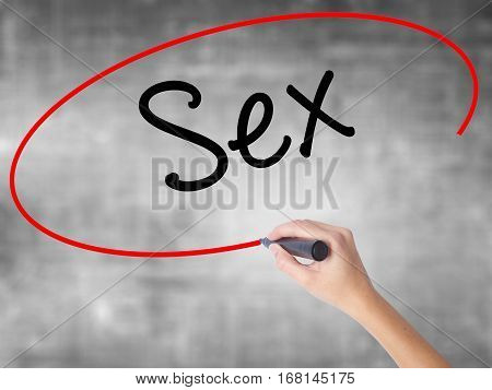 Woman Hand Writing Sex With Black Marker Over Transparent Board