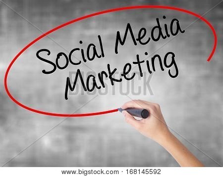 Woman Hand Writing Social Media Marketing With Black Marker Over Transparent Board