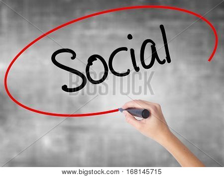 Woman Hand Writing Social With Black Marker Over Transparent Board