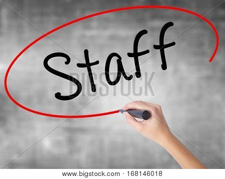 Woman Hand Writing  Staff With Black Marker Over Transparent Board