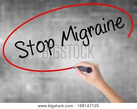 Woman Hand Writing Stop Migraine  With Black Marker Over Transparent Board