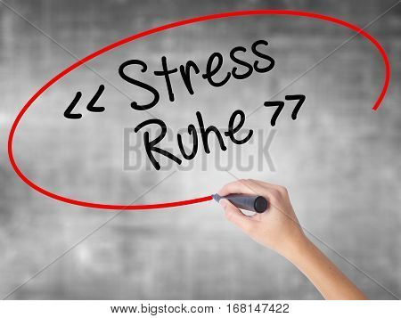Woman Hand Writing Stress Ruhe  (stress - Peacein German) With Black Marker Over Transparent Board.