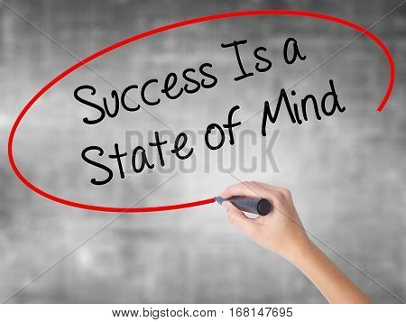 Woman Hand Writing Success Is A State Of Mind With Black Marker Over Transparent Board