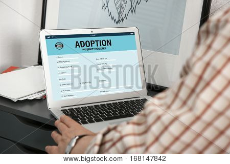 Adoption concept. Man filling in paternity form on tablet