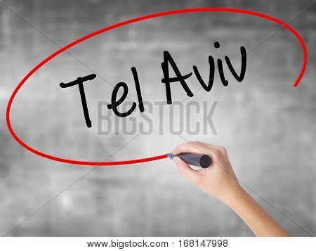 Woman Hand Writing Tel Aviv  With Black Marker Over Transparent Board