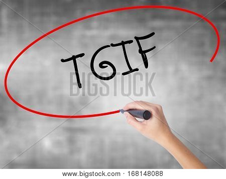 Woman Hand Writing Tgif With Black Marker Over Transparent Board