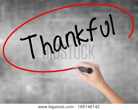 Woman Hand Writing Thankful  With Black Marker Over Transparent Board
