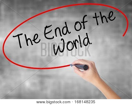 Woman Hand Writing The End Of The World With Black Marker Over Transparent Board