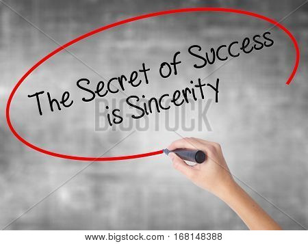 Woman Hand Writing The Secret Of Success Is Sincerity With Black Marker Over Transparent Board.