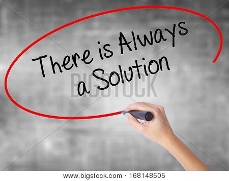 Woman Hand Writing There Is Always A Solution With Black Marker Over Transparent Board