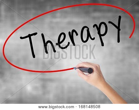 Woman Hand Writing Therapy With Black Marker Over Transparent Board