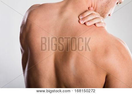Close-up Of A Shirtless Man With Backache
