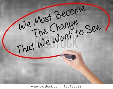 Man Hand Writing We Must Become The Change That We Want To See With Black Marker On Visual Screen