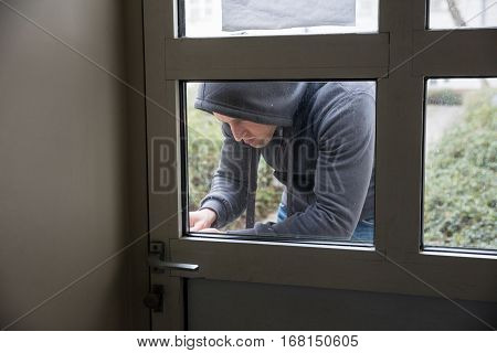 Close-up Of A Man Opening The Door Of A House