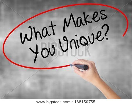 Man Hand Writing What Makes You Unique? With Black Marker On Visual Screen