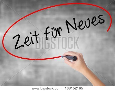Man Hand Writing Zeit Fur Neues (time For Something New In German) With Black Marker On Visual Scree