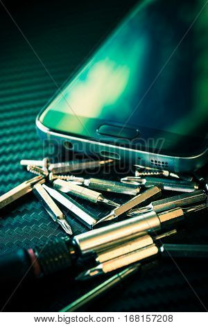 Smartphone Repair Concept Closeup Photo. Smartphone Upgrading.