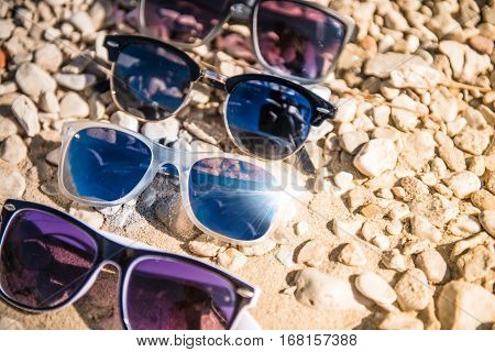 Sunglasses on the Rocky Beach Vacation Theme.