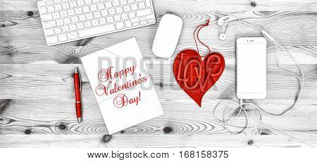 Office Workplace with Red Heart Phone Headphones Keyboard Stationary and Office Supplies. Valentines Day decoration