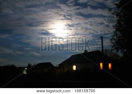Rural house at night in full moon light
