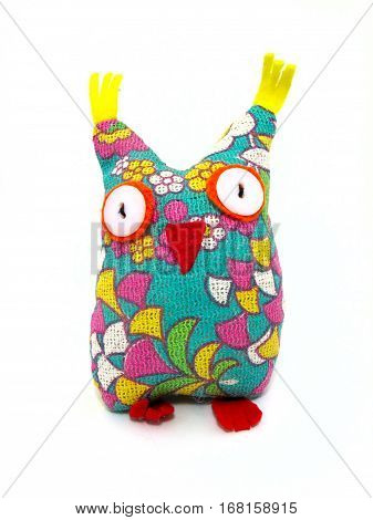 Colorful owl handmade sewn textile toy with big button eyes