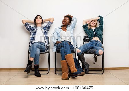 Three Different Ethnic Women Waiting In Line For Interview