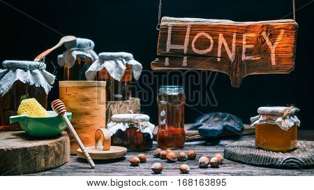Counter in honey shop. Wood sign in beam of golden light. Concept for sign of honey store