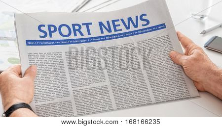 Man Reading Newspaper With The Headline Sport News