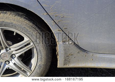 Poltavskaya village Russia - January 15 2017: The mud on the wheels fenders and car doors. The result is a trip through the mud. Dirty car.