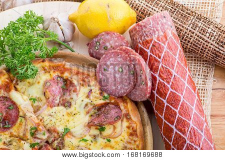 Italian Pizza On Wooden Table. True Hot Tasty Pizza With Salami, Mushrooms, Basil, Olives, Pepper An