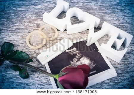 concept valentine day red rose and test love on brown wooden background vintage tone