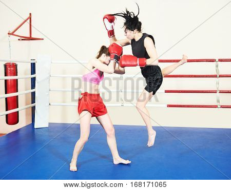 Muay thai woman fighting at boxing ring
