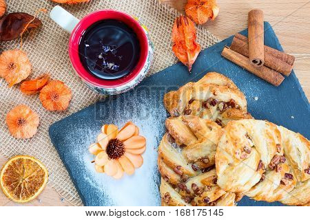 marple and pecan plait pastry sweet food breakfast with tea cup and flower